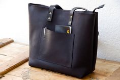 Large Black Distressed Leather bag with leather outside pocket. Premium sturdy waxed leather. Handmade