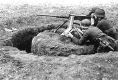 Germans soldiers using a captured M2 .50 heavy machine gun in a rather complex and fully 360° entrenched position, notice the addition of the MGZ sight from the MG 34/42 when set up with a tripod.