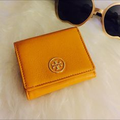 SaleTory Burch Wallet Like new tri fold wallet in mustard yellow! Not using it but might still keep this! Soo cute! Tory Burch Bags Wallets