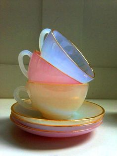 adore these pastel glass teacups and saucers they look as if they're made of sugar and water