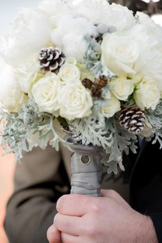 Rose, dusty miller, pine cone and peony bouquet by Brocade Designs. Photo by Matt Andrews