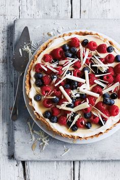 Berry and White Choc Tart by Annabel Karmel 'This show-stopping dessert couldn't be simpler. The buttery biscuit base is covered with a delicious combination of cream cheese and smooth white chocolate, then topped with fresh berries, which you could swap for whichever fruits are in season'