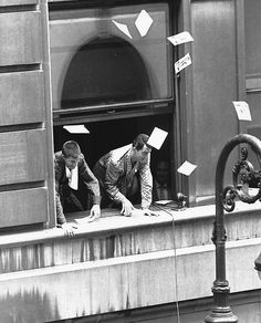 Dean and Jerry throwing photographs out of their dressing room window at the Paramount Theatre in New York City