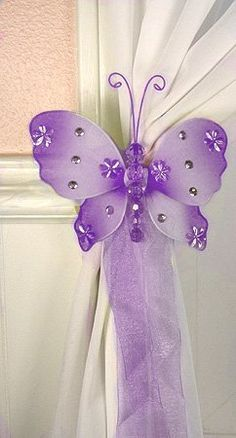 Nylon Butterfly Curtain Tieback - Purple Emily (sold individually) by The Butterfly Grove, http://www.amazon.com/dp/B00272BD50/ref=cm_sw_r_pi_dp_ktIBrb16Q02HZ