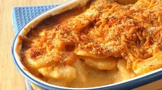 Enjoy these delicious potatoes topped with cheese and bread crumbs – perfect for a side dish.