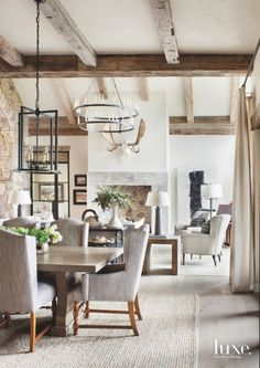 Fireplace Background Dining Room With Iron Chandelier And Neutral Seating