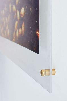 Turn average posters into gallery-worthy pieces with just two sheets of plexiglass and four bolts.
