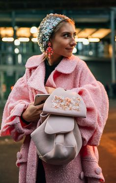 Pink doesn't have to be saccharine sweet - the perennially well-dressed Jenny Walton twinkles in a sequin beret, embellished Simone Rocha bag and sparkly boucle coat. Check our Instagram Stories for the best looks from LFW courtesy of street style snapper Tommy Ton #styledotTon