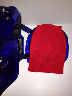 Cool-Catcher cold gel pack holder, which attaches to the back of a hockey style catchers mask.