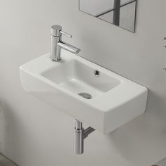 modern, sleek self-rimming or wall mounted bathroom sink. Sink includes one faucet hole on the left side of the sink and an overflow. This beautiful, space saving bathroom sink is made of high-quality white ceramic. Sink is designed by luxury and well Space Saving Bathroom, Drop In Bathroom Sinks, White Bathroom, Very Small Bathroom, Bathroom Toilets, Tiny Bath, Tiny Wet Room, Small Sink, Ideas