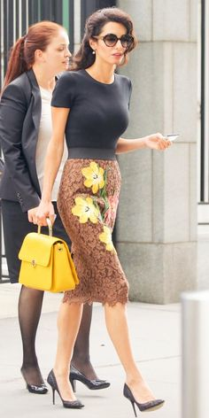 Luxury fashion brands are struggling to sell their costly clothes and moving into other products instead. Pictured above, Amal Clooney wears a Dolce & Gabbana skirt and carries a Aigner bag Amal Clooney, George Clooney, Office Fashion, Work Fashion, Fashion 2018, Fashion Tv, Kpop Fashion, Indian Fashion, Fashion Brands