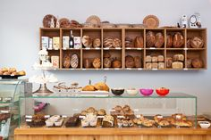 showcase next to coffee machine for one of our trademark items....zuchini loaves, muffins, etc...so people see it as they walk in......