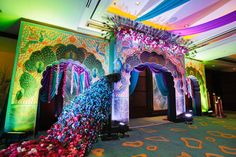 A stunning giant peacock installation for a Peacock theme Sangeet for the Real Wedding of Kamali and Nikhil of WeddingSutra.
