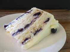 This homemade, triple layered lemon cake with fresh blueberries is topped with a cream cheese frosting. Lemon Layer Cakes, Layer Cake Recipes, Blueberry Cake, Blueberry Recipes, Huckleberry Cake Recipes, Snack Recipes, Dessert Recipes, Desserts, Homemade Cherry Pies