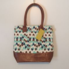 New Handwoven JOYN tote, made by the hands of woman in India. Fun block print with brown leather. Never been used.