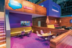 Rimmed by comparably expressionless exhibits in a show hall at CeBIT 2015, Salesforce.com's exhibit was a tropical oasis in hues of purple, yellow, green, pink, and blue.