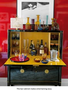 July / August 2013 US House Beautiful Review lacquered black coctail bar with yellow interior
