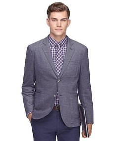 A knit blazer like this one is given more formality paired with a sharp dress shirt and tie.