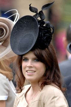 Princess Eugenie- she seems to like these newer hats that are styled after satellite dishes.