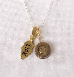 Akawelle strongheart necklace, made with bullet shell casings from the Liberian civil war. 100% of the proceeds go to support the Strongheart Fellowship.