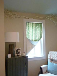 Woodland nursery, love the branch over the window!