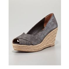 """Tory Burch Sz 9B Pre Owned Espadrille Wedges EUC Tory Burch Size 9- Pre Owned- Wedges have a little disclosing from wear on the front. Filipa Wedge Espadrille, Pewter Linen gets a luxe makeover on these Tory Burch wedges. A shimmery finish makes them work for day or night. •Shimmer linen. •Straps crisscross over vamp. •Signature double-""""T"""" embroidery on side of heel. •3 1/4"""" braided jute wedge heel; 1 1/4"""" platform; 2"""" equiv. •Rubber outsole. •""""Filipa"""" is made in Spain. Tory Burch Shoes…"""