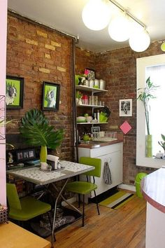 Stylishly decorated tiny kitchen and dining space with brick wall || @pattonmelo