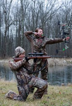 Crystal Warms and Jodi Zwart modeling in their hunting gear. Camo. Bow. Rifle. Girls can hunt too!