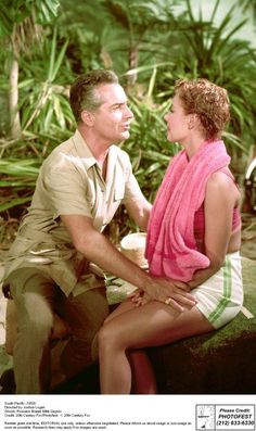 South Pacific Emile De Becque (Rossano Brazzi) is taken with Nellie Forbush (Mitzi Gaynor) after first meeting her at a navy sponsored dance. Nellie is requested by her superiors to keep an eye on the French planter and report back to them. John Kerr, Ruth Roman, Judy Holliday, Lew Ayres, Robert Cummings, Joseph Cotten, Mitzi Gaynor, John Garfield, Dana Andrews