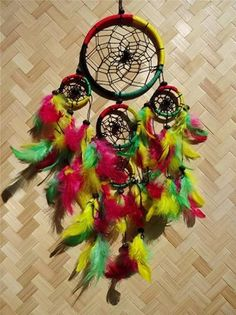 Photo: STUNNING RASTA DREAM CATCHER WITH BEAUTIFUL ASSORTED RASTA FEATHERS.