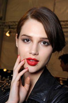 Matching scarlet lips and nails at Dior