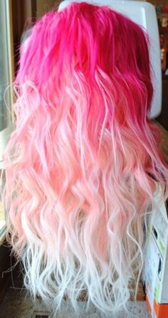 gradient pink mermaid hair...Idk...it may just be me, but I don't care for people coloring their hair funky shades, but this one's actually kinda pretty.