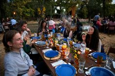 Diners smoke marijuana as they eat dishes prepared by chefs during an evening of pairings of fine food and craft marijuana strains served to invited guests dining at Planet Bluegrass, an outdoor venue in Lyons, Colo.