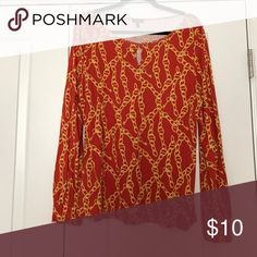 Top Long sleeves; gold chain pattern on burned orange background; oval peephole in front; tee shirt material Talbots Tops