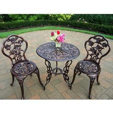Relax outdoors with the Rose Bistro Patio Set. A charming and traditional rose pattern is set into the round table and two chairs to blend with your outdoor ambience. This outdoor bistro patio set is perfect for tea in the garden or patio, or deck. Garden Furniture Sets, Outdoor Garden Furniture, Garden Chairs, Balcony Furniture, Bistro Patio Set, Bistro Tables, Cafe Tables, Bistro Chairs, Pc Table