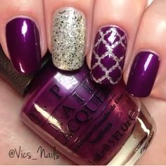 Purple nails with gold accents