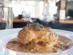 Cheddar biscuits smothered in ancho chili sausage gravy from Proper.