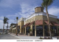 Find strip mall stock images in HD and millions of other royalty-free stock photos, illustrations and vectors in the Shutterstock collection. Thousands of new, high-quality pictures added every day. Mall Facade, Strip Mall, Multi Story Building, Royalty Free Stock Photos, Street View, Construction, Architecture, Pictures, Image