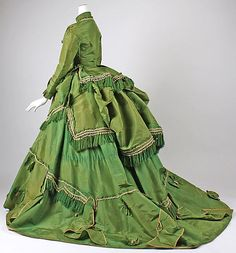 1868 green silk dress with the polonaise revival bustled skirt. Does anyone else think of Scarlet O' Hara