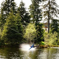 """Ziplining in Astoria (after a visit to the """"Goonies"""" house).  Photo by Chris Burkard."""