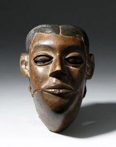 Nigeria, Ibibio people, early 20th century CE. This is a wooden maskette with an articulated jaw and a naturalistic face; the combed down hair style is characteristic of the Ibibio culture. The face has surprising depth and swirling marks on the jawline; these might represent scarification? Other Ibibio masks, such as one held by the Australian Museum, display similar marks painted on the face. The Ibibio live in southeastern Nigeria on the Niger River Delta. Wealth in this society came…