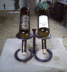 2 bottle wine rack made with rail road spike by ClayBobEnterprises