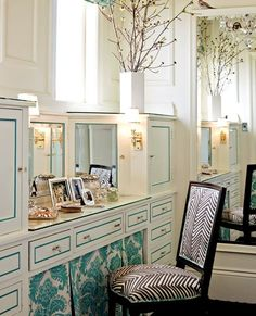 So pretty. The teal fabric skirting, and the teal detailing on the cabinet/drawer doors is just perfect.