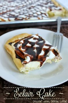 {Dessert Now, Dinner Later!} Eclair Cake - an eclair made into a cake.  Puffy pate choux crust topped with french vanilla pudding, whipped cream, & chocolate sauce.  An easy, yet elegant dessert to serve a crowd. #dessert #party