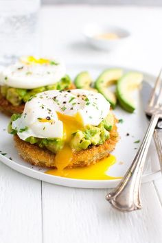 Fried Green Tomatoes with Avocados and Poached Eggs - slices of green tomatoes get coated and lightly fried until they're golden brown and crunchy on the outside and just barely soft on the inside. Then they're topped with some mashed avocado and poached eggs. Perfect for breakfast, lunch or dinner! | tamingofthespoon.com