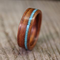 Santos Rosewood Bentwood Ring with Offset Turquoise Inlay - Handcrafted Wooden Ring. $175.00, via Etsy.