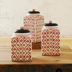 "RED FLOWER CANISTERS, SET OF 3 -- Store dry goods in our beautiful handpainted canisters with a vintage floral pattern, fitted with wood lids lined with rubber gaskets to keep contents fresh. Imported. Set of 3, one of each size. Small, 5""W x 5""D x 8-1/4""H"