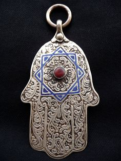 Africa | A silver, carnelian and blue enamel 'Khamsa' from the Dra Valley of Morocco. | © Liuba Berti.