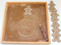 Gingerbread salt sensory tray.  1 tsp cinnamon, 1 tsp ginger and 1 tsp allspice to approximately 1/2 cup of salt and stirred it through very carefully until it was all combined and the colour was well mixed. Keep dry cinnamon away from the kids as it can be dangerous if inhaled. Once thoroughly mixed into the salt base it is  fine to use in this way. The sensory tray smelt amazing!