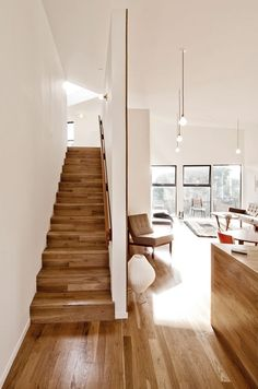 Light; Shining: giving out or reflecting bright light. Light can be seen shining off of the fresh hardwood floor.